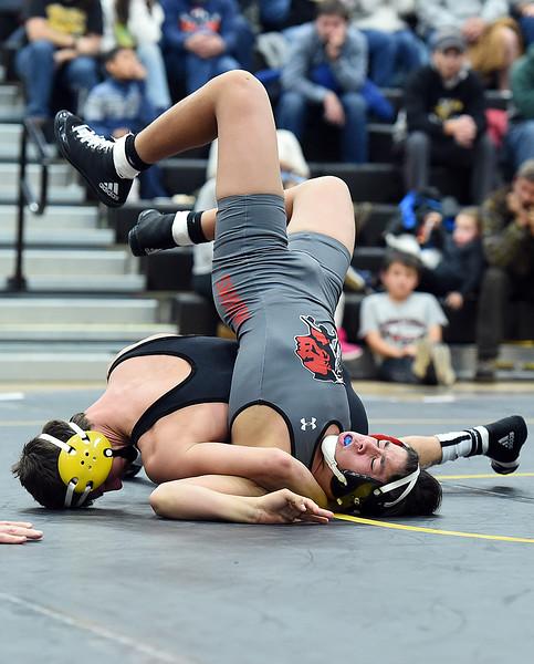 Thompson Valley's Zach Kennison wrestles Loveland's Cody Donovan during their 145-pound match Friday, Dec. 9, 2016, at Thompson Valley High School in Loveland. Kennison won the match.  (Photo by Jenny Sparks/Loveland Repdorter-Herald)