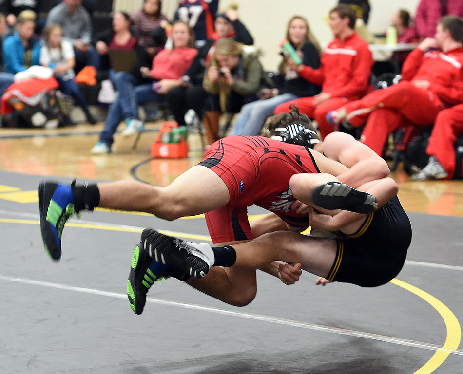 Loveland's Nado Villalobos takes down Thompson Valley's Aaron Allee during their 138-pound match Friday, Dec. 9, 2016, at Thompson Valley High School in Loveland. Villalobos won the match.  (Photo by Jenny Sparks/Loveland Repdorter-Herald)