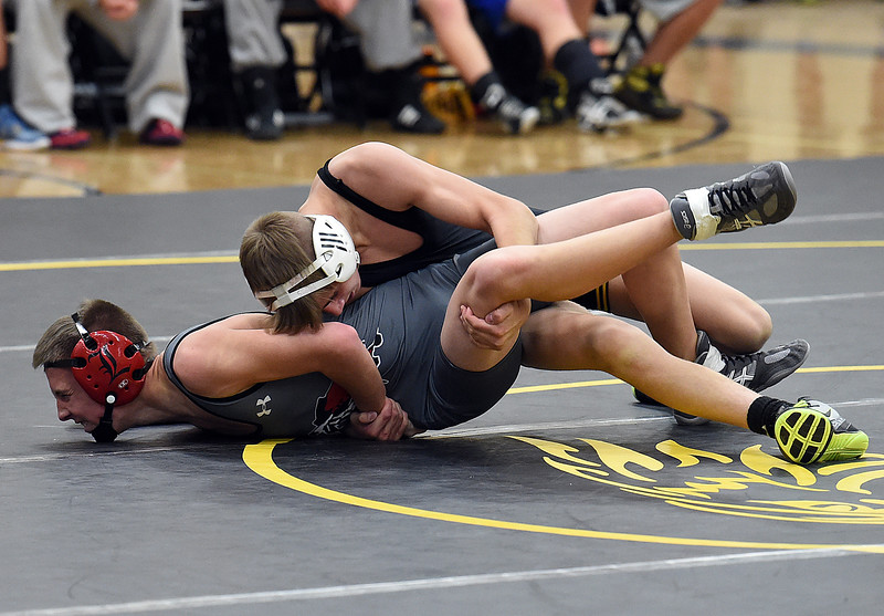 Thompson Valley's Airiel Siegel wrestles Loveland's Isaac Lujan during their 113-pound match Friday, Dec. 9, 2016, at Thompson Valley High School in Loveland. Siegel won the match.  (Photo by Jenny Sparks/Loveland Repdorter-Herald)