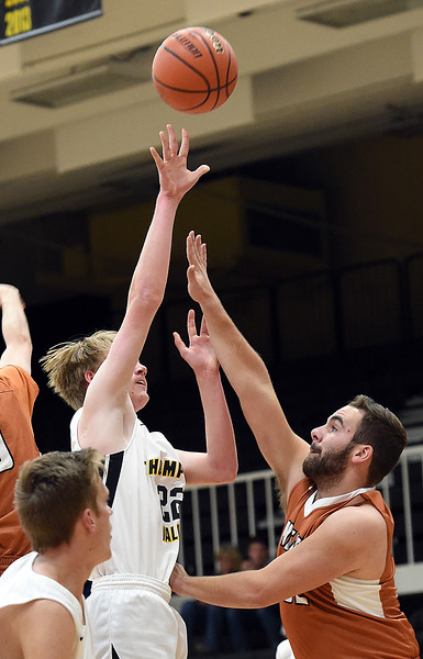 Thompson Valley's Matthew Lessman goes up for a shot as Mead's KJ Jacobs tries to block during their game Tuesday, Dec. 11, 2018, at Thompson Valley in Loveland.   (Photo by Jenny Sparks/Loveland Reporter-Herald)