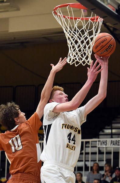 Thompson Valley's Jaromy Morgan goes up for a shot as Mead's Caleb Ayers tries to block during their game Tuesday, Dec. 11, 2018, at Thompson Valley in Loveland.   (Photo by Jenny Sparks/Loveland Reporter-Herald)