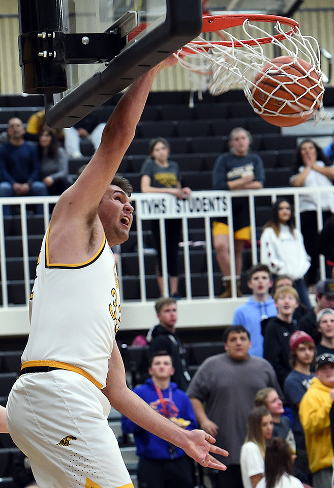 Thompson Valley's (33) Jared Kasprzak dunks the ball during their game against Mountain View Wednesday, Jan. 24, 2018, at Thompson Valley in Loveland.  (Photo by Jenny Sparks/Loveland Reporter-Herald)