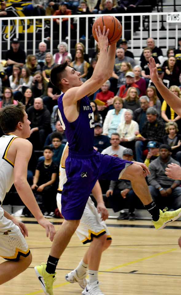 Mountain View's (20) Brexton Butcher jumps for an open shot between Thompson Valley's defense during their game on Friday, Jan. 26, 2018 at Thompson Valley High School in Loveland. Photo by Thieng Mai.