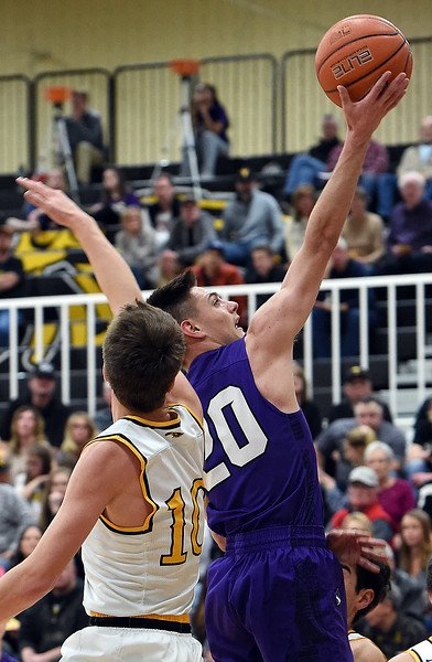 Mountain View's (20)Brexton Butcher goes up for a shot past Thompson Valley's (10) Justin Wiersema during their game Wednesday, Jan. 24, 2018, at Thompson Valley in Loveland.  (Photo by Jenny Sparks/Loveland Reporter-Herald)
