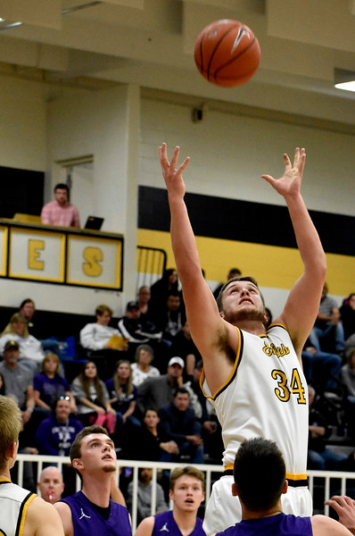 Thompson Valley's (34) Joey Shaffer aims to grab the rebound shot after Mountain View attempt to score during their game on Friday, Jan. 26, 2018 at Thompson Valley High School in Loveland. Photo by Thieng Mai.