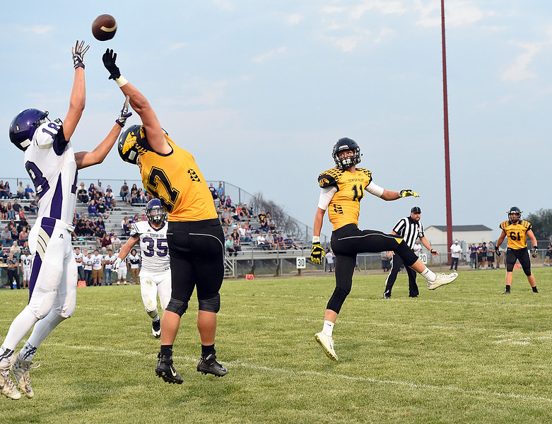 Mountain View's (18) Baylor Brigham and Thompson Valley's (47) Joey Shaffer go up for a pass Friday, Aug. 30, 2017, during their game at Patterson Stadium in Loveland. (Photo by Jenny Sparks/Loveland Reporter-Herald)  47 18