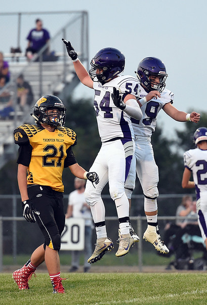 Mountain View's (19) Chad Baumann and (54) Justin Sweet celebrate Baumann's touchdown Friday, Aug. 30, 2017, during their game against Thompson Valley at Patterson Stadium in Loveland. (Photo by Jenny Sparks/Loveland Reporter-Herald)