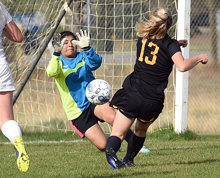 Mountain View's goalie Beatriz Lopez blocks a shot by Thompson Valley's #13 Caitlin Skees Tuesday, April 18, 2017, during their game at Mountain View High School in Loveland. (Photo by Jenny Sparks/Loveland Reporter-Herald)