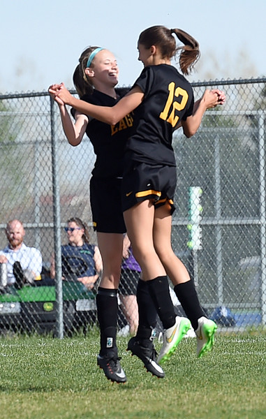Thompson Valley's #12 Elizabeth Bryson and #19 Bailey Bottoms celebrate Bryson scoring their third goal Tuesday, April 18, 2017, during their game aagainst Mountain View High School in Loveland. (Photo by Jenny Sparks/Loveland Reporter-Herald)