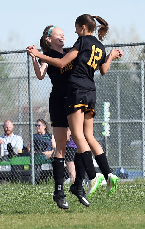 . Thompson Valley\'s #12 Elizabeth Bryson and #19 Bailey Bottoms celebrate Bryson scoring their third goal Tuesday, April 18, 2017, during their game aagainst Mountain View High School in Loveland. (Photo by Jenny Sparks/Loveland Reporter-Herald)