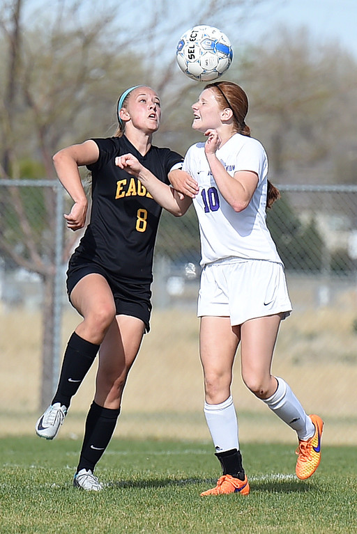 . Thompson Valley\'s #8 Kylee Morris and Mountain View\'s #10 Nicole Rogers go up for a header Tuesday, April 18, 2017, during their game at Mountain View High School in Loveland. (Photo by Jenny Sparks/Loveland Reporter-Herald)