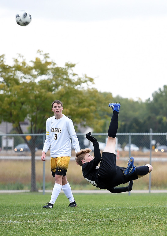 . Mountain View\'s (10) Christian Soliz is up-ended as he kicks the ball behind him to try to score during their game against Thompson Valley on Tuesday, Oct. 9, 2018, at Mountain View High School in Loveland.  (Photo by Jenny Sparks/Loveland Reporter-Herald)