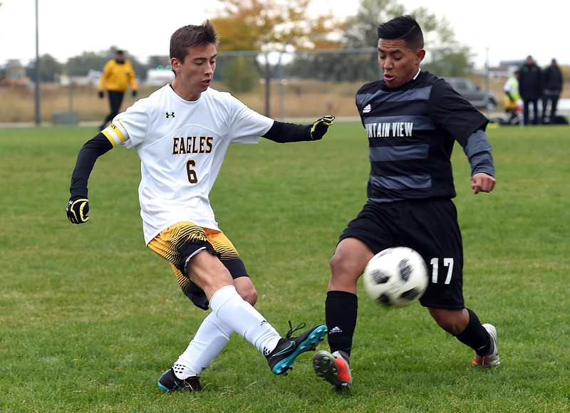 Thompson Valley's (6) Trevor Engelland and Mountain View's (17) Edgar Erives-Salinas battle for control of the ball during their game Tuesday, Oct. 9, 2018, at Mountain View High School in Loveland.  (Photo by Jenny Sparks/Loveland Reporter-Herald)