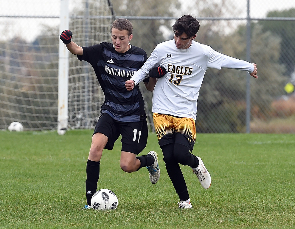 . Mountain View\'s (11) Justin Condon and Thompson Valley\'s (13) Ian Levin battle for control of the ball during their game Tuesday, Oct. 9, 2018, at Mountain View High School in Loveland.  (Photo by Jenny Sparks/Loveland Reporter-Herald)