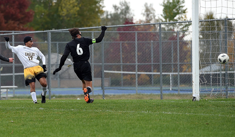 Thompson Valley's (17) Dillon Saenz scores during their game against Mountain View Tuesday, Oct. 9, 2018, at Mountain View High School in Loveland.  (Photo by Jenny Sparks/Loveland Reporter-Herald)