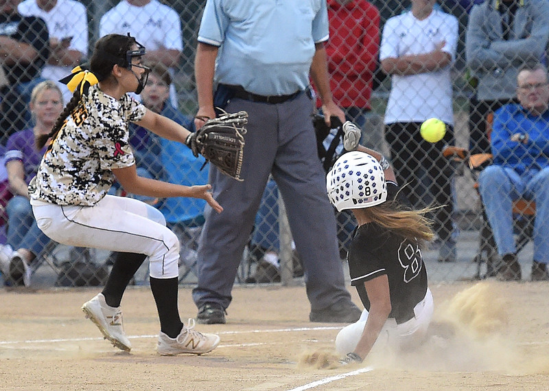 Mountain View's (8) Jaycee Schroeder slides into home as Thompson Valley's (11) Makenna McVay keeps her eye on the ball Tuesday, Sept. 6, 2017, during their game at Centennial Park in Loveland. (Photo by Jenny Sparks/Loveland Reporter-Herald)   m8  t11