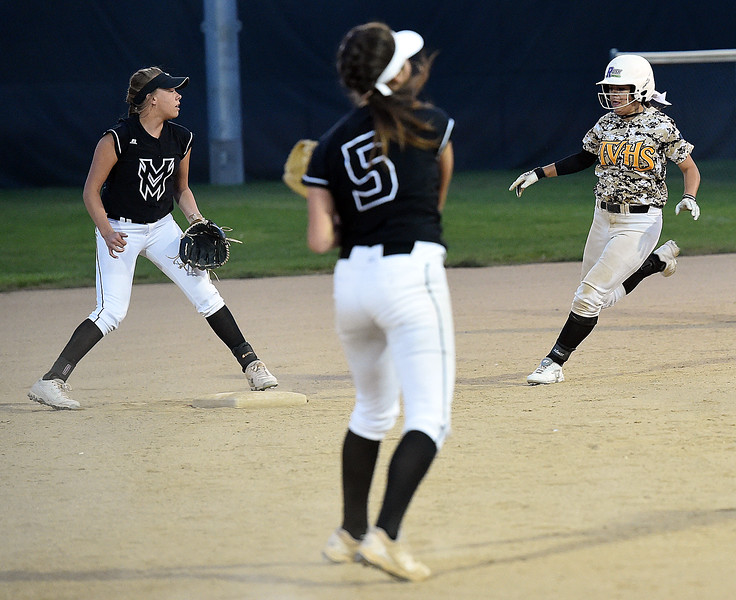 Thompson Valley's (2) Kylea Wall runs to second as Mountain View's (2) Aliyah McComas keeps her eye on the ball Tuesday, Sept. 6, 2017, during their game at Centennial Park in Loveland. (Photo by Jenny Sparks/Loveland Reporter-Herald)