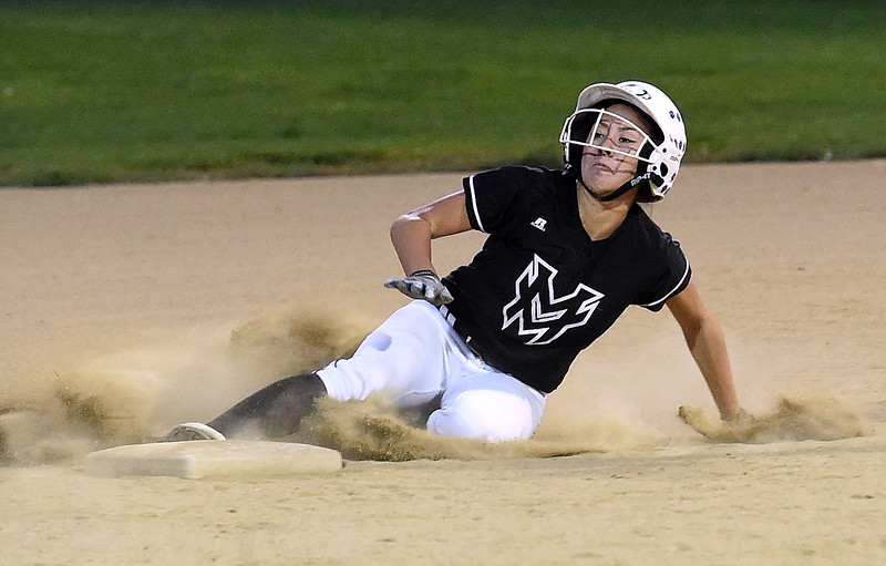 Mountain View's (5) Izzy Griego slides into second Tuesday, Sept. 6, 2017, during their game against Thompson Valley at Centennial Park in Loveland. (Photo by Jenny Sparks/Loveland Reporter-Herald) m5<br /> t2  7