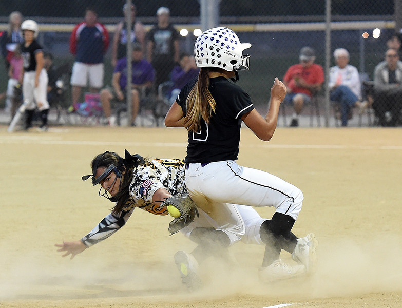 Mountain View's (3) Jaelyn Taylor runs to third base as Thompson Valley's (12) Cassie Orozco tries to tag her out Tuesday, Sept. 6, 2017, during their game at Centennial Park in Loveland. (Photo by Jenny Sparks/Loveland Reporter-Herald)