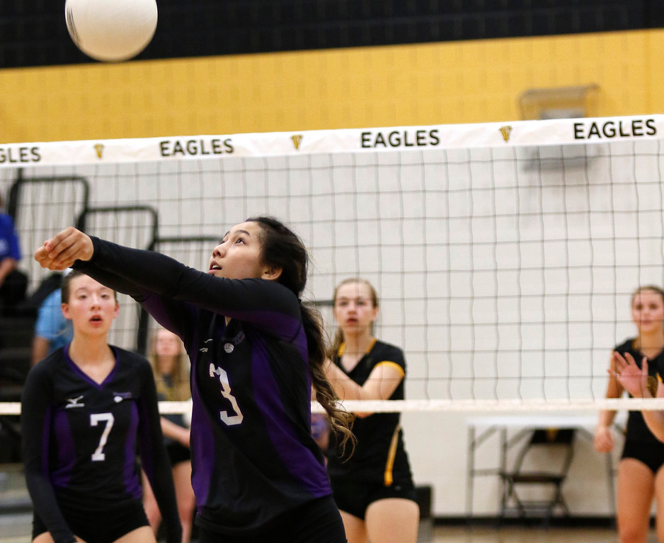 Mountain View's Janae Onda (3) hits the ball backward to return it to Thompson Valley at Thompson Valley gym on Thursday, Sept. 14, 2017. (Photo by Lauren Cordova/Loveland Reporter-Herald)