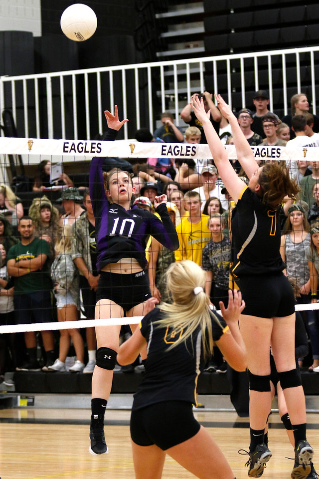Mountain View's Megan Hurr (10) hits the ball back as Thompson Valley's Charleigh Cooper (7) tries to block it at Thompson Valley gym on Thursday, Sept. 14, 2017. (Photo by Lauren Cordova/Loveland Reporter-Herald)