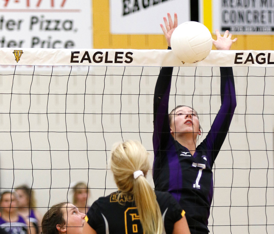 Mountain View's Kayla Jones (7) spikes the ball at Thompson Valley gym on Thursday, Sept. 14, 2017. (Photo by Lauren Cordova/Loveland Reporter-Herald)