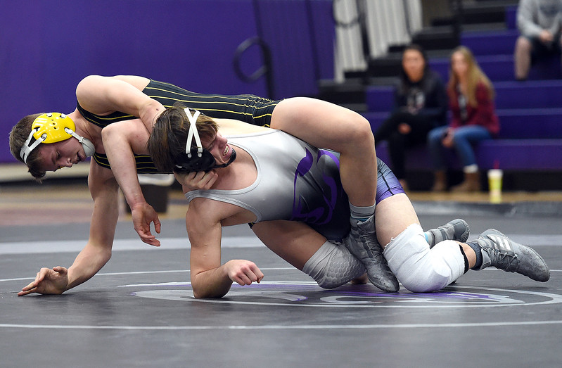 Thompson Valley's Hunter Williams wrestles Mountain Views Jackson Gilbert during their 160 pound match Thursday, Jan. 11, 2018, at Mountain View High School in Loveland. Williams won the match.  (Photo by Jenny Sparks/Loveland Reporter-Herald)