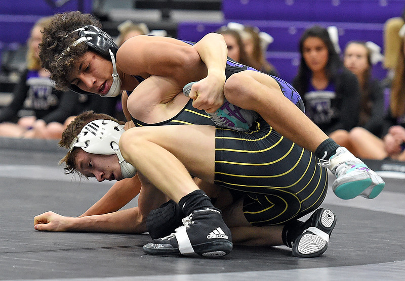 Mountain View's Malachi Contreras wresltes Thompson Valley's Gage Juergensen during their 126 pound match Thursday, Jan. 11, 2018, at Mountain View High School in Loveland. Contreras won the match.  (Photo by Jenny Sparks/Loveland Reporter-Herald)