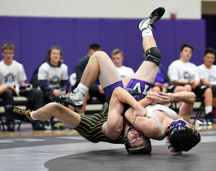 Thompson Valley's Chase Engelhardt wrestles Mountain Views Chad Baumann during their 152 pound match Thursday, Jan. 11, 2018, at Mountain View High School in Loveland. Engelhardt won the match.  (Photo by Jenny Sparks/Loveland Reporter-Herald)