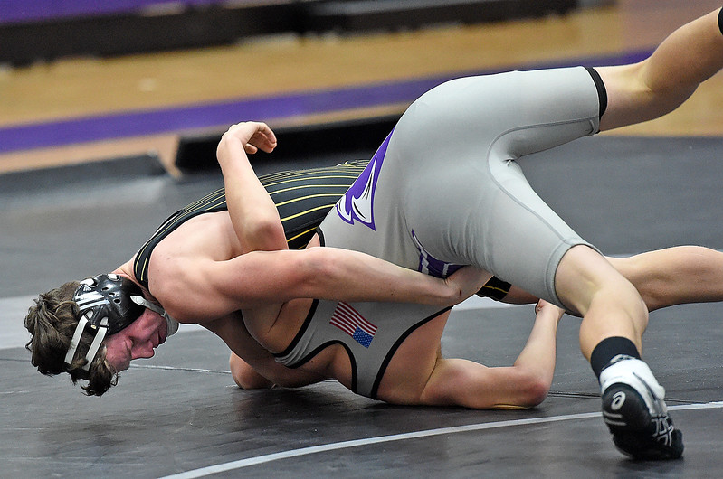 Thompson Valley's Aaron Allee wrestles Mountain Views CJ Bever during their 132 pound match Thursday, Jan. 11, 2018, at Mountain View High School in Loveland. Alee won the match.  (Photo by Jenny Sparks/Loveland Reporter-Herald)