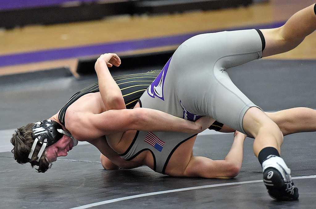. Thompson Valley\'s Aaron Allee wrestles Mountain Views CJ Bever during their 132 pound match Thursday, Jan. 11, 2018, at Mountain View High School in Loveland. Alee won the match.  (Photo by Jenny Sparks/Loveland Reporter-Herald)