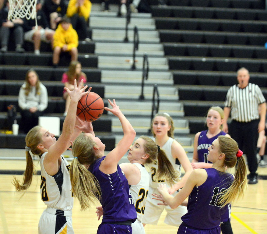 . Mountain View\'s Angel Scruggs (center) battles with Thompson Valley\'s Sam McCrimmon (back) for a rebound in Tuesday\'s game at the TVHS gym. (Mike Brohard/Loveland Reporter-Herald)