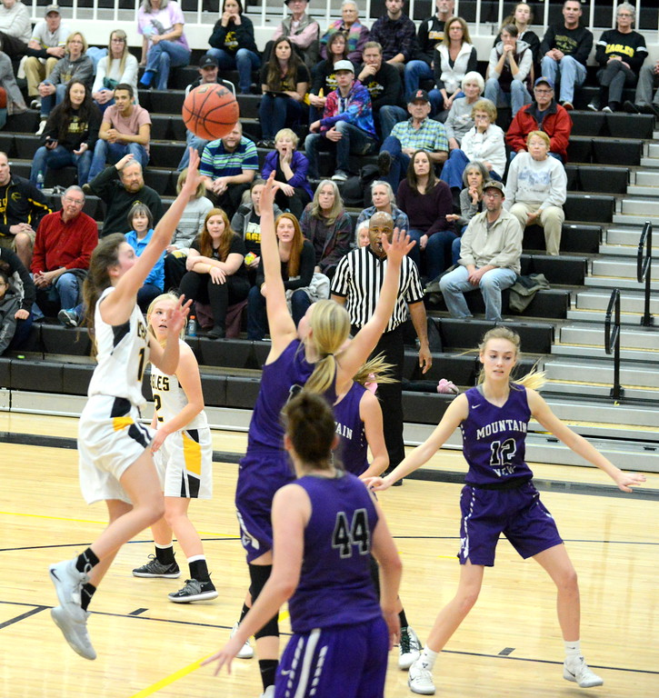 . Thompson Valley\'s Kylie Bowen gets off a floater over the defense of Mountain View\'s Harley Duke in Tuesday\'s crosstown matchup at Thompson Valley. Bowen led all scorers with 20 points in the Eagles\' 53-31 victory. (Mike Brohard/Loveland Reporter-Herald)