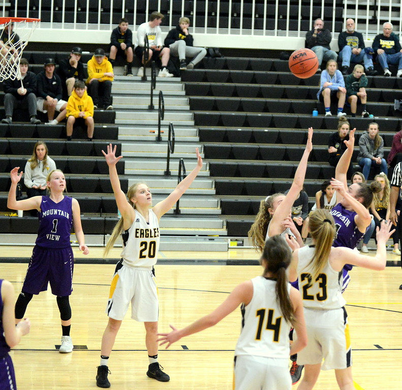 . Mountain View\'s RaLeigh Basart hits a shot in the lane over the Thompson Valley defense in Tuesday\'s crosstown game at the TVHS gym. Basart scored 15 to lead the Mountain Lions. (Mike Brohard/Loveland Reporter-Herald)