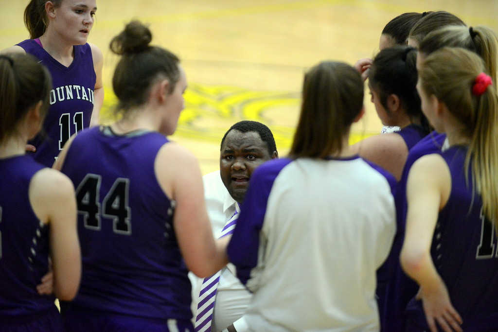 . Mountain View coach Jason Walker talks to his team during a timeout in the second quarter of Tuesday\'s game at Thompson Valley. (Mike Brohard/Loveland Reporter-Herald)