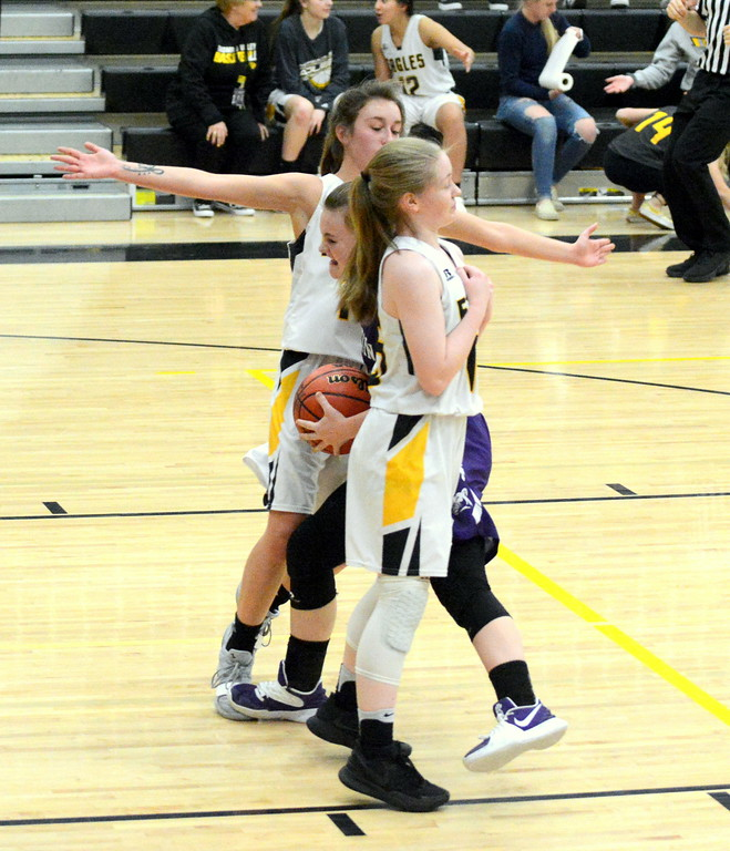 . Mountain View\'s Kelsey Basart (center) draws the foul as Thompson Valley\'s Ameilia Solt (foreground) tries to draw a charge with teammate Kylie Bowen providing help in Tuesday\'s game at the TVHS gym. (Mike Brohard/Loveland Reporter-Herald)