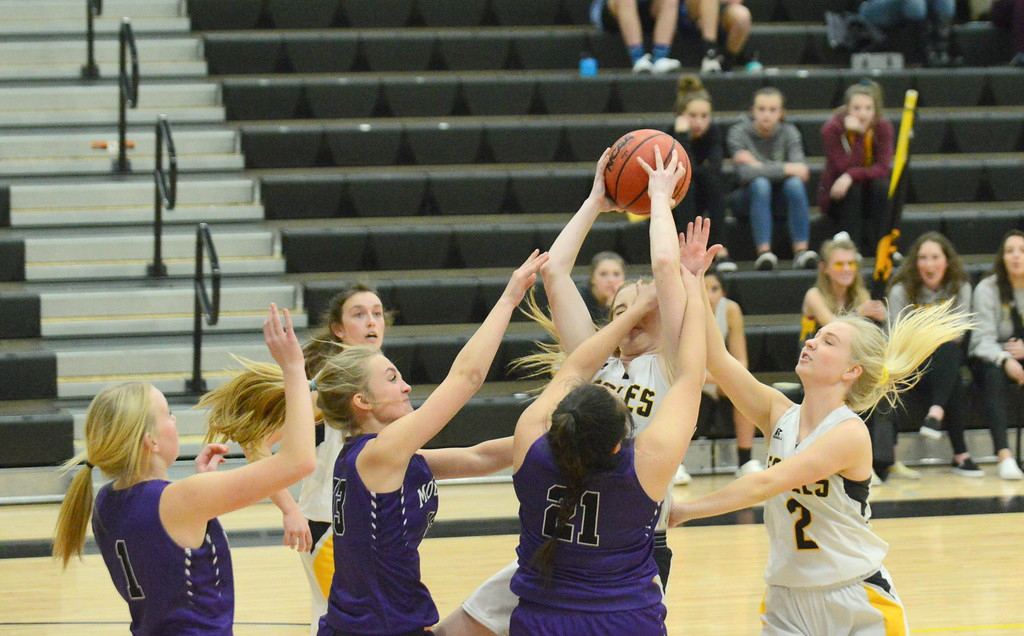 . Thompson Valley\'s Sydney Duertshe (center) grabs a rebound with the hand of Mountaiin View\'s Ashlyn Trujillo in her face during Tuesday\'s game at the TVHS gym. The Eagles won the crosstown battle 53-31. (Mike Brohard/Loveland Reporter-Herald)