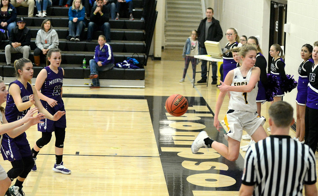 . Thompson Valley\'s Emily Black tries to save a ball from going out of bounds during Tuesday\'s game with Mountain View at the TVHS gym. (Mike Brohard/Loveland Reporter-Herald)