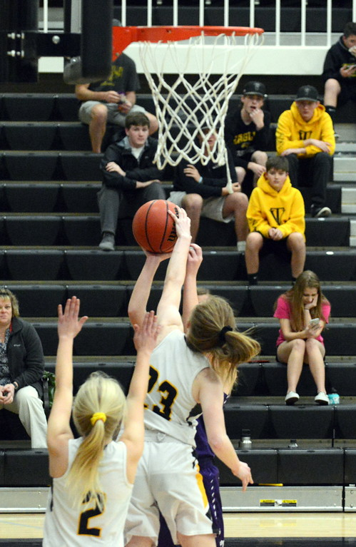 . Thompson Valley\'s Sydney Durtsche gets the block on Mountain View\'s Harley Duke\'s shot during the first quarter of Tuesday\'s game at Thompson Valley. (Mike Brohard/Loveland Reporter-Herald)