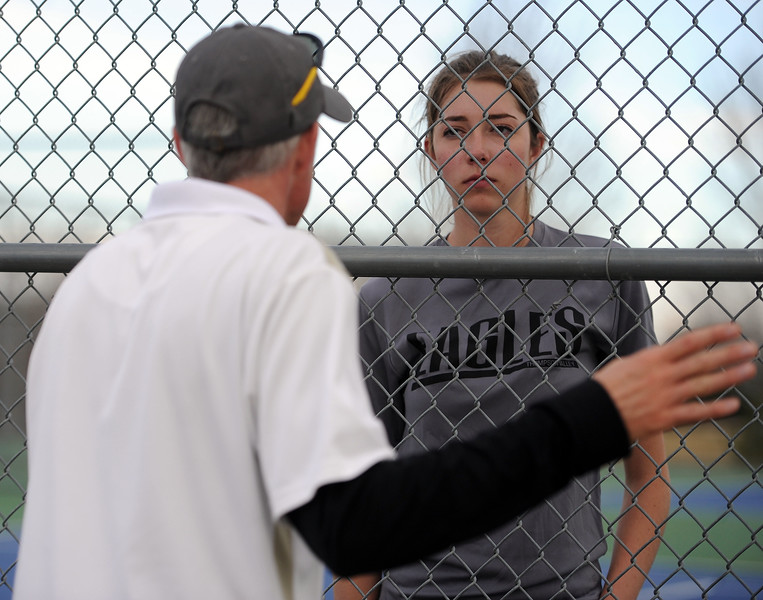 Kylie Jacobson listens while coach Jay Klagge gives her advice against Mountain View on Thursday, April 4. Thompson Valley won 7-0. (Colin Barnard/Loveland Reporter-Herald)