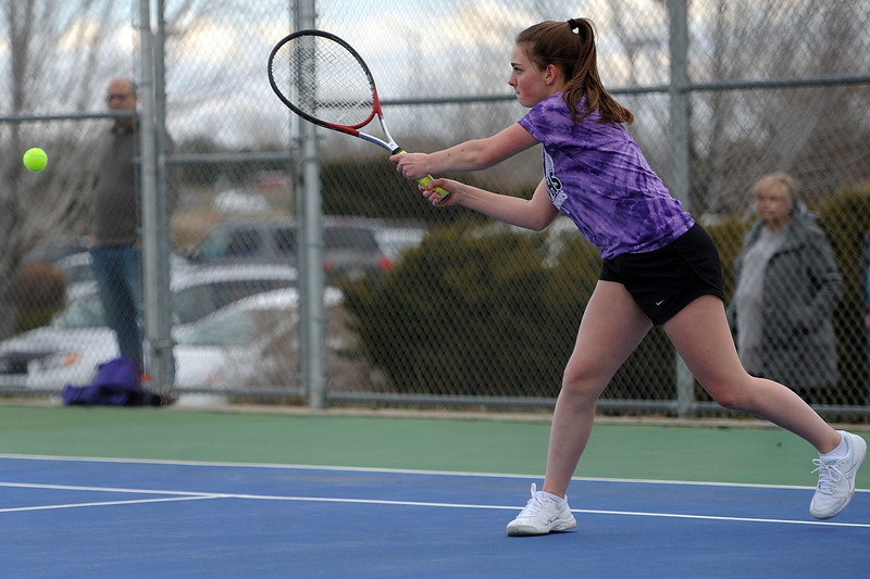 Mountain View's Hope Brown finishes a backhand against Thompson Valley in the No. 2 doubles match on Thursday, April 4. Thompson Valley won 7-0. (Colin Barnard/Loveland Reporter-Herald)