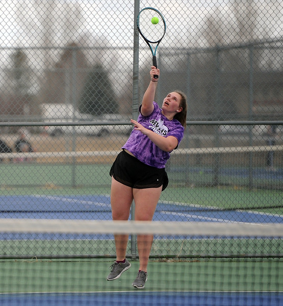 Mountain View's Natalie Alsum connects on a serve during the No. 3 singles match against Thompson Valley on Thursday, April 4. Thompson Valley won 7-0. (Colin Barnard/Loveland Reporter-Herald)