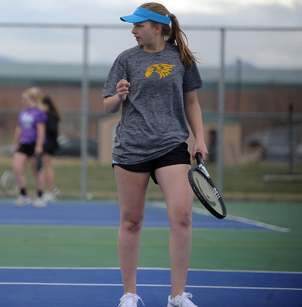 Thompson Valley's Sydney Laws pumps her fist after a point in the No. 2 doubles match on Thursday, April 4. Thompson Valley won 7-0. (Colin Barnard/Loveland Reporter-Herald)