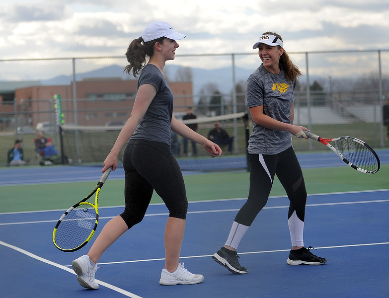 Thompson Valley's Autumn Porter, right, and Kalysa Christopher smile after winning a game in the No. 1 doubles match on Thursday, April 4. Thompson Valley won 7-0. (Colin Barnard/Loveland Reporter-Herald)