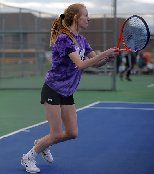 Mountain View's RyLynn Neally reacts to a drop shot during the No. 1 doubles match against Thompson Valley on Thursday, April 4. Thompson Valley won 7-0. (Colin Barnard/Loveland Reporter-Herald)