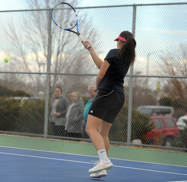 Thompson Valley's Emmalee Dekkers sends a forehand back during the No. 2 doubles match on Thursday, April 4. Thompson Valley won 7-0. (Colin Barnard/Loveland Reporter-Herald)