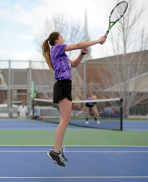 Mountain View's Kendall Krieger jumps for a volley during her No. 2 singles match against Thompson Valley on Thursday, April 4. Thompson Valley won 7-0. (Colin Barnard/Loveland Reporter-Herald)
