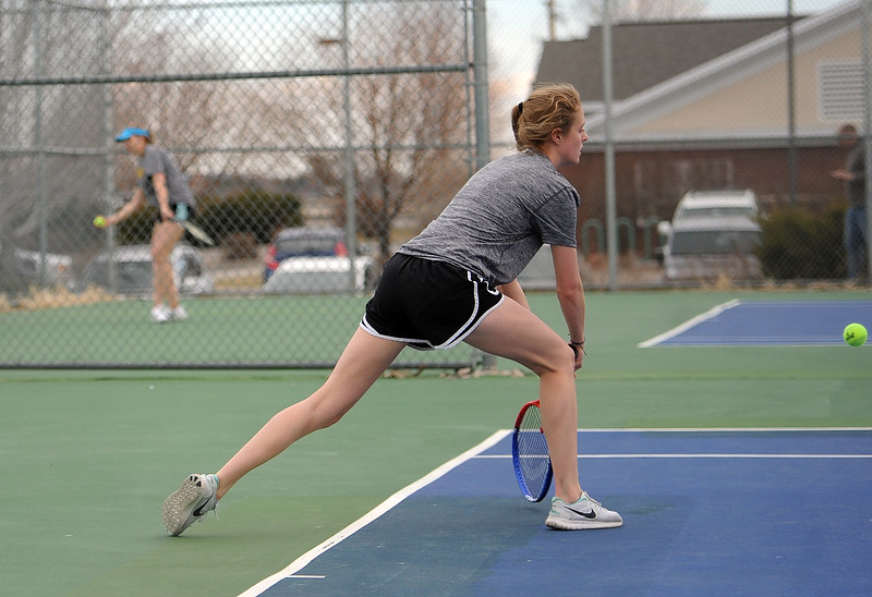 Thompson Valley's Emily Black leans into a backhand in the No. 3 singles match agaisnt Mountain View on Thursday, April 4. Thompson Valley won 7-0. (Colin Barnard/Loveland Reporter-Herald)