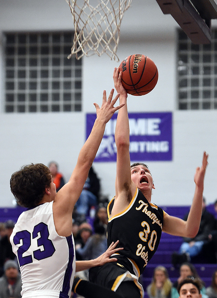 Thompson Valley's #30 Mitch Zundel goes up for a shot as Mountain View's #23Kaleb Cahalan tries to block during their game Friday, Jan. 6, 2017, at Mountain View High School in Loveland. (Photo by Jenny Sparks/Loveland Reporter-Herald)