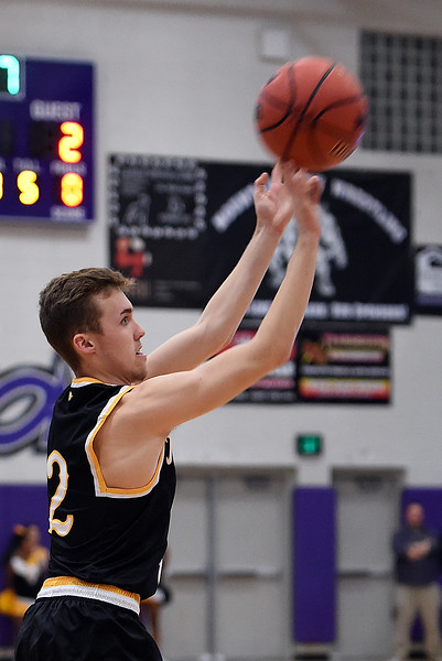 Thompson Valley's #2Jeremy Wagonmaker shoots the ball  during their game against Mountain View Friday, Jan. 6, 2017, at Mountain View High School in Loveland. (Photo by Jenny Sparks/Loveland Reporter-Herald)